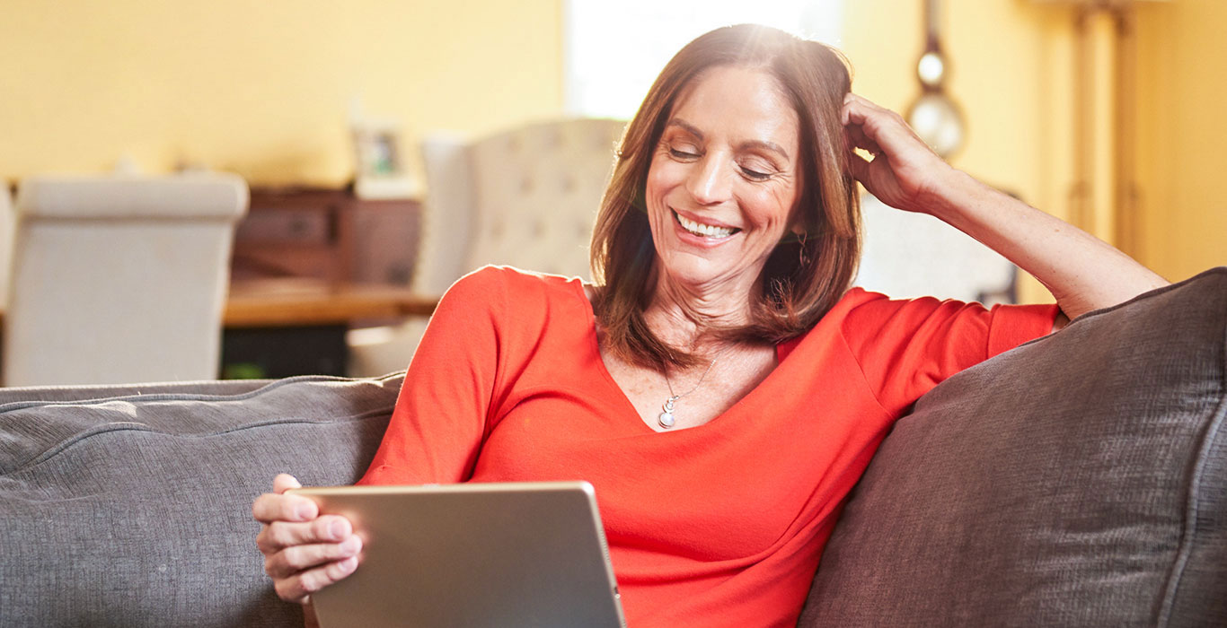 Relaxed woman reviewing her plan options